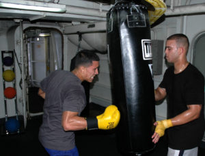 090814-N-1245S-007 PACIFIC OCEAN (Aug. 14, 2009) Aviation BoatswainÕs Mate (Handling) 3rd Class Hector Castro and Aviation BoatswainÕs Mate (Handling) 3rd Class Roman Vasquez train on a punching bag aboard the aircraft carrier USS Nimitz (CVN 68). Nimitz and embarked Carrier Air Wing (CVW) 11 are underway on a scheduled deployment to the western Pacific Ocean. (U.S. Navy photo by Mass Communication Specialist 2nd Class Gregory A. Streit /Released)